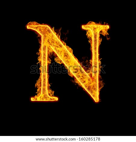 Fire alphabet letter N isolated on black background. - stock photo