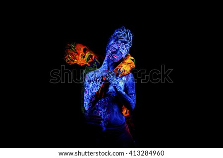 Fire and Air. Body art glowing in ultraviolet light, four elements, isolated on black background - stock photo