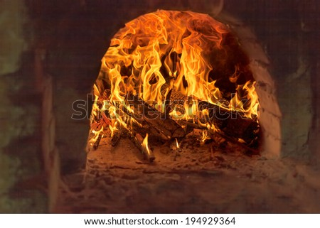 Fire and flames - Firewood burning in old brick furnace - stock photo