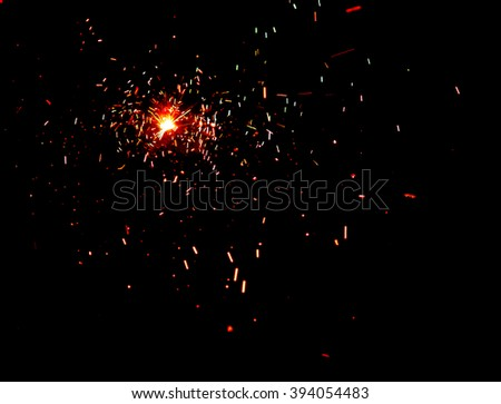 fire and sparks on a black background.