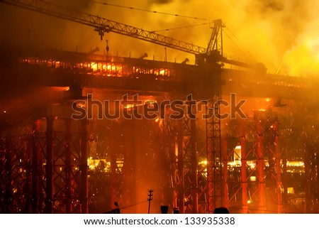 fire at bridge construction site - stock photo