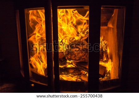 Fire at fireplace - stock photo