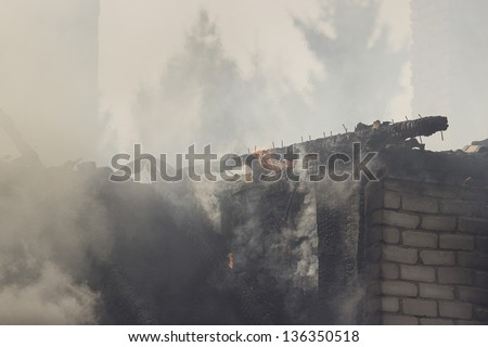 fire at suburban residence - stock photo