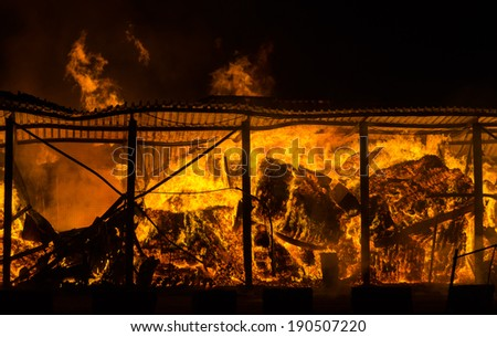 Fire at the industrial warehouse - stock photo