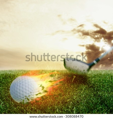 Fire ball hit by a golf club - stock photo