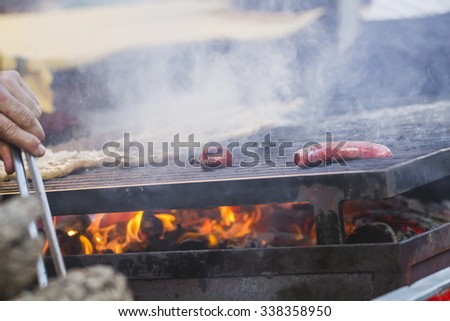 fire, barbecue with sausages and lamb in a medieval fair, Spain - stock photo