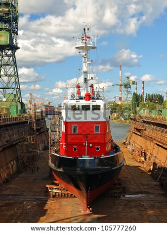 Fire-boat in floating dry dock. Gdansk, Poland. - stock photo