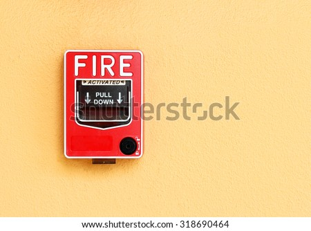 fire break glass alarm switch on the cement wall - stock photo