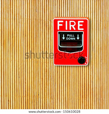 fire break glass on the bamboo wall - stock photo