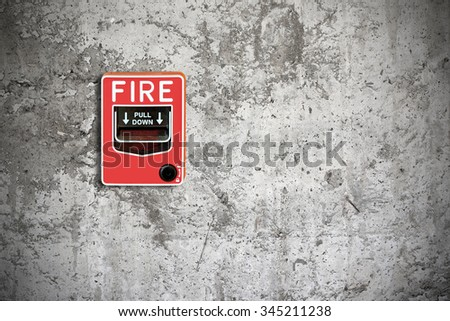 fire break glass on the concrete wall background - stock photo