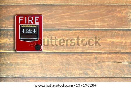 fire break glass on the wood wall - stock photo