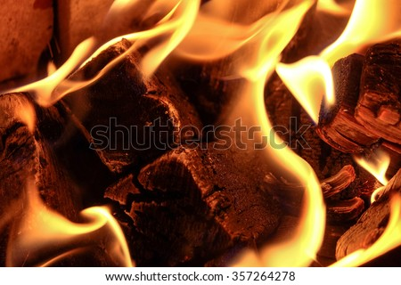 Fire. Burning charcoal in the grill. - stock photo