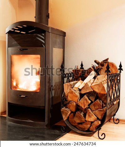 Fire burning on the fireplace - stock photo