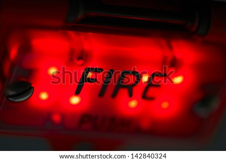 Fire - close up view on the control panel in the airplane - stock photo