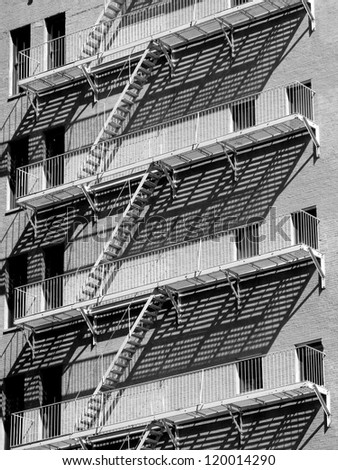 Fire escape and shadows in Brooklyn, New York - stock photo