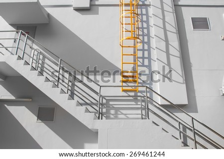 Fire escape ladder on the side of building  - stock photo