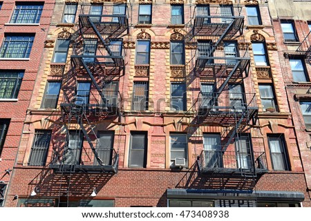 Fire escape on exterior of walk up apartment building in lower Manhattan, New York City