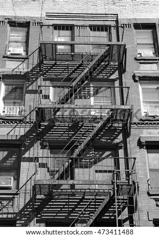 Fire escape on exterior of walk up apartment building in New York City