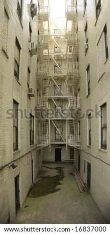 Fire escape on the backside of an building in manhattan, new york - stock photo