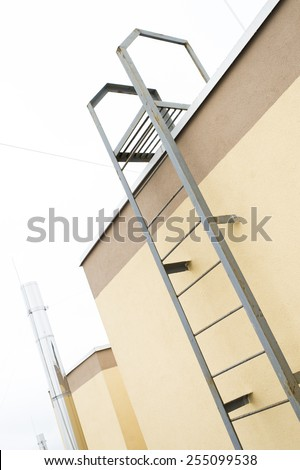 fire escape on the roof of new building - stock photo