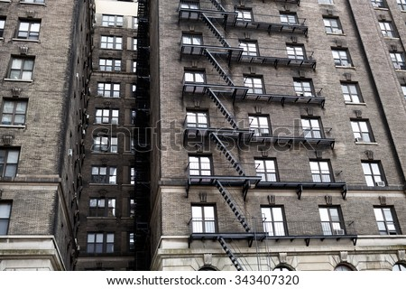 fire escape on the wall of old brick building - stock photo