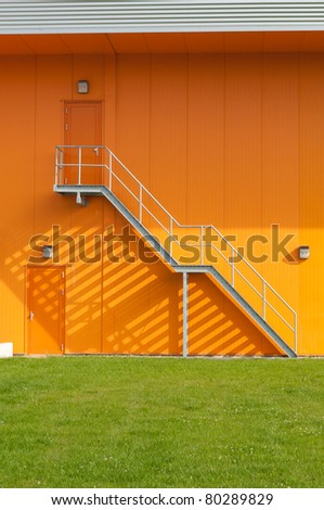 fire escape stair on a industrial building - stock photo