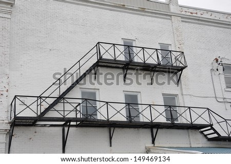 Fire exit ladder - stock photo