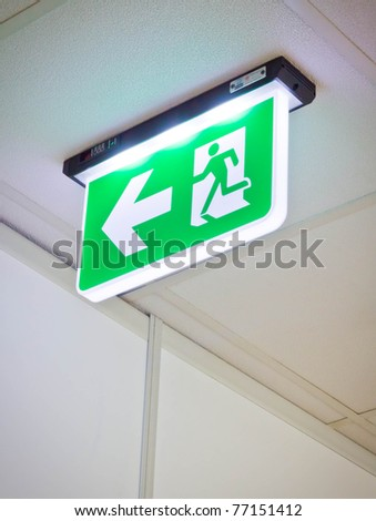 fire exit sign - stock photo