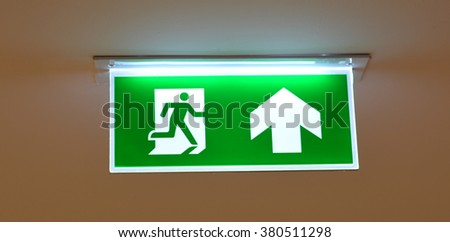 Fire Exit Sign with green color background and light - stock photo