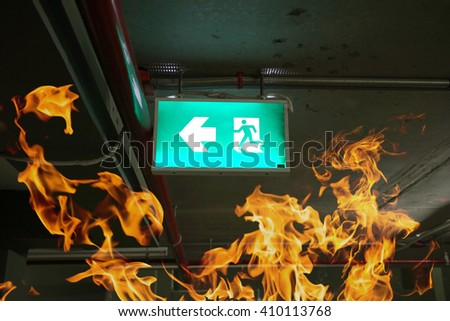 fire exits in car park and frame of fire burn - stock photo