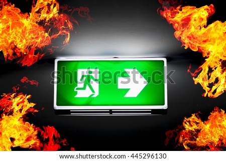Fire exits in car park area and frame of fire burn. - stock photo