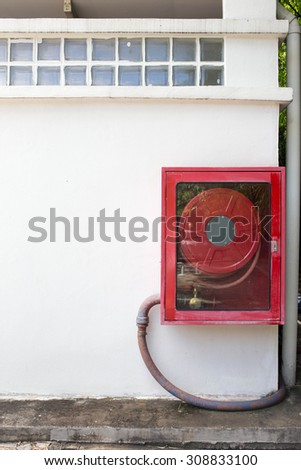 Fire extinguisher equipment on the wall