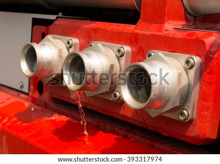 fire extinguisher head pipe with pouring water  - stock photo