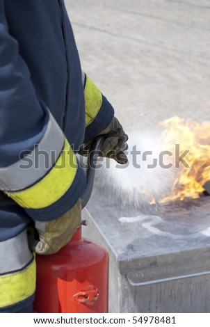 Fire extinguisher in action - stock photo