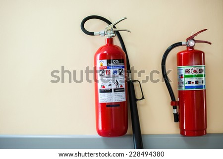 Fire-extinguisher isolated with clipping path - stock photo