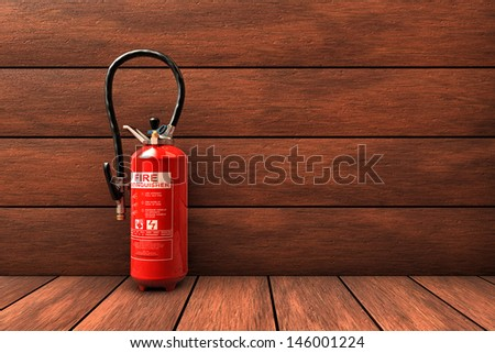 Fire extinguisher on wood room - stock photo