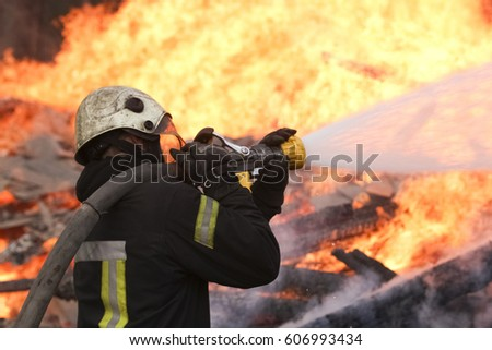Fire fighter at work on fire