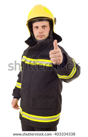 fire fighter going thumb up, isolated on white background - stock photo