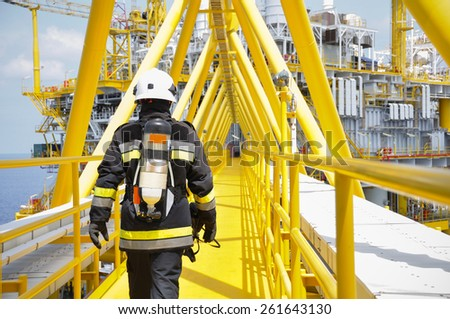 Fire fighter on oil and gas industry, successful firefighter at work - stock photo