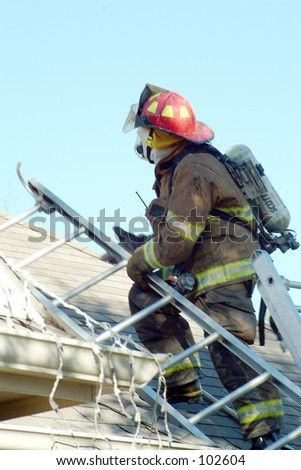 Fire fighter on roof with ladder