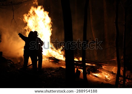 Fire fighters at a burning house