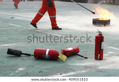 fire fighting training and used extinguisher - stock photo