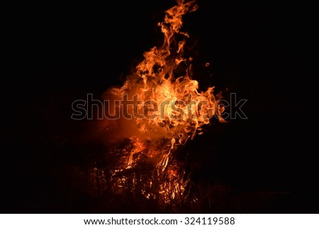 Fire fire. Burning of rice straw at night. - stock photo