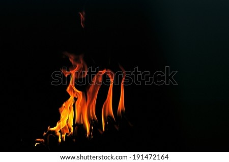 Fire flames around a heart wire - stock photo