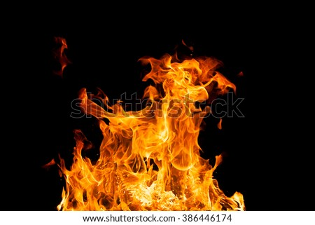 Fire flames - isolated on black background. Real photo - stock photo