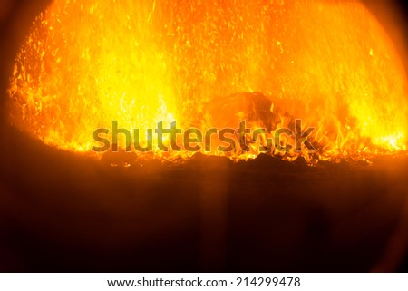 fire flames of a bonfire or a fireplace - stock photo
