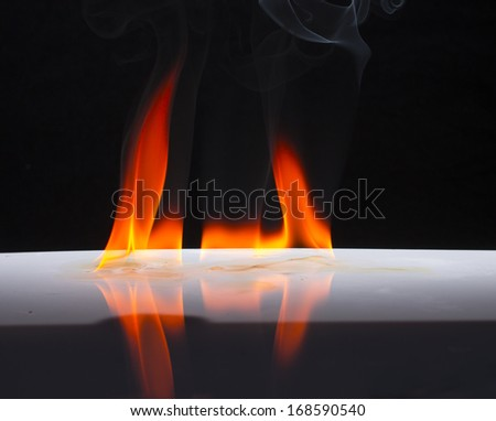 Fire flames on a  background
