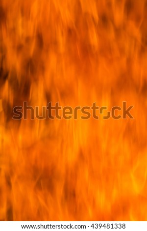 Fire flames on a black background. Blaze fire flame texture background. Close up of fire flames isolated on black background. Burn. Abstract fire flames background. Texture. Blurred - stock photo
