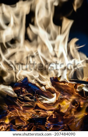 Fire flames with burnt paper texture - stock photo