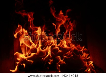 Fire flames with reflection on dark background - stock photo